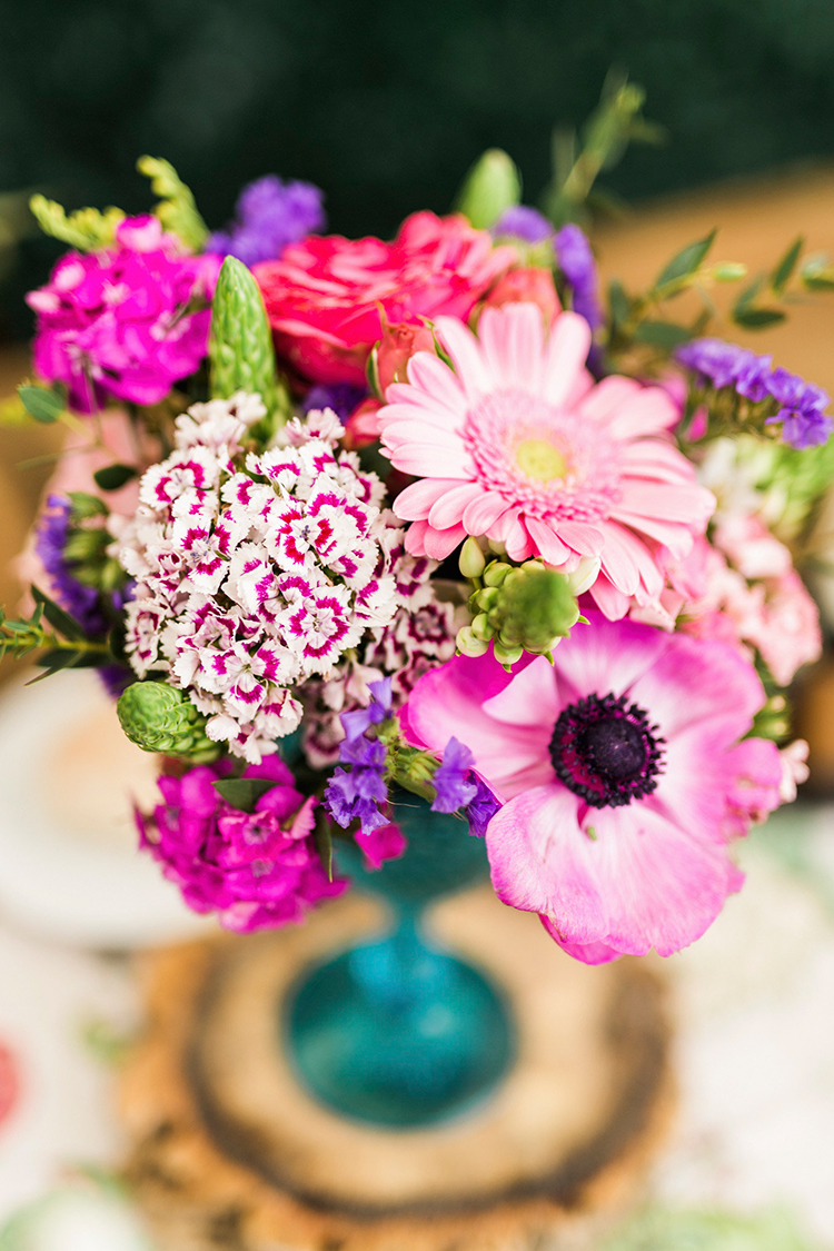 purple wedding centerpieces - photo by Passionate https://ruffledblog.com/bohemian-wedding-in-portugal-with-bright-flowers-everywhere