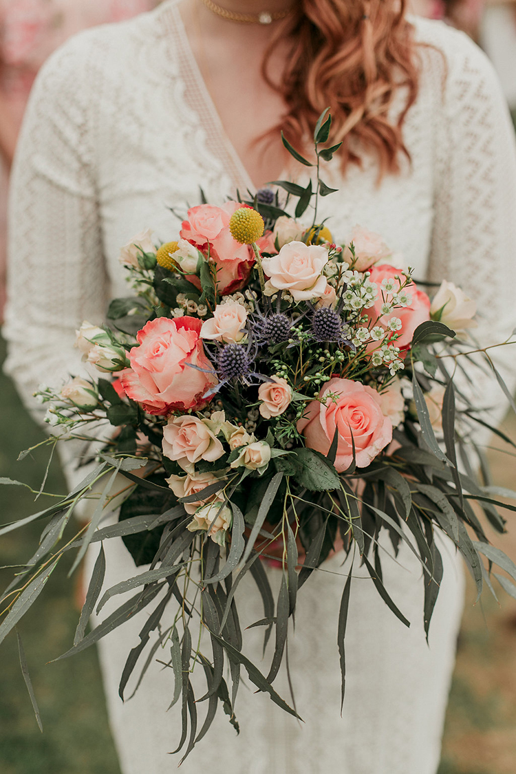 romantic bouquets with pink roses - photo by Sarah White Photography http://ruffledblog.com/boho-bridal-shower-inspiration-for-your-bride-tribe
