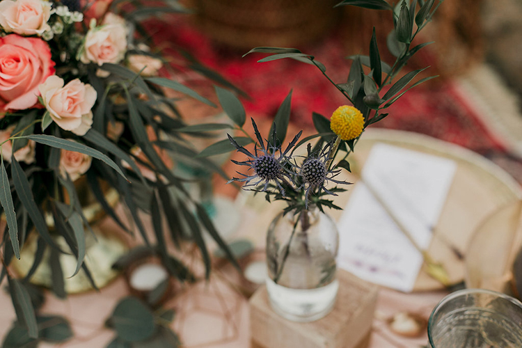 billy ball bud vases with thistle - photo by Sarah White Photography https://ruffledblog.com/boho-bridal-shower-inspiration-for-your-bride-tribe