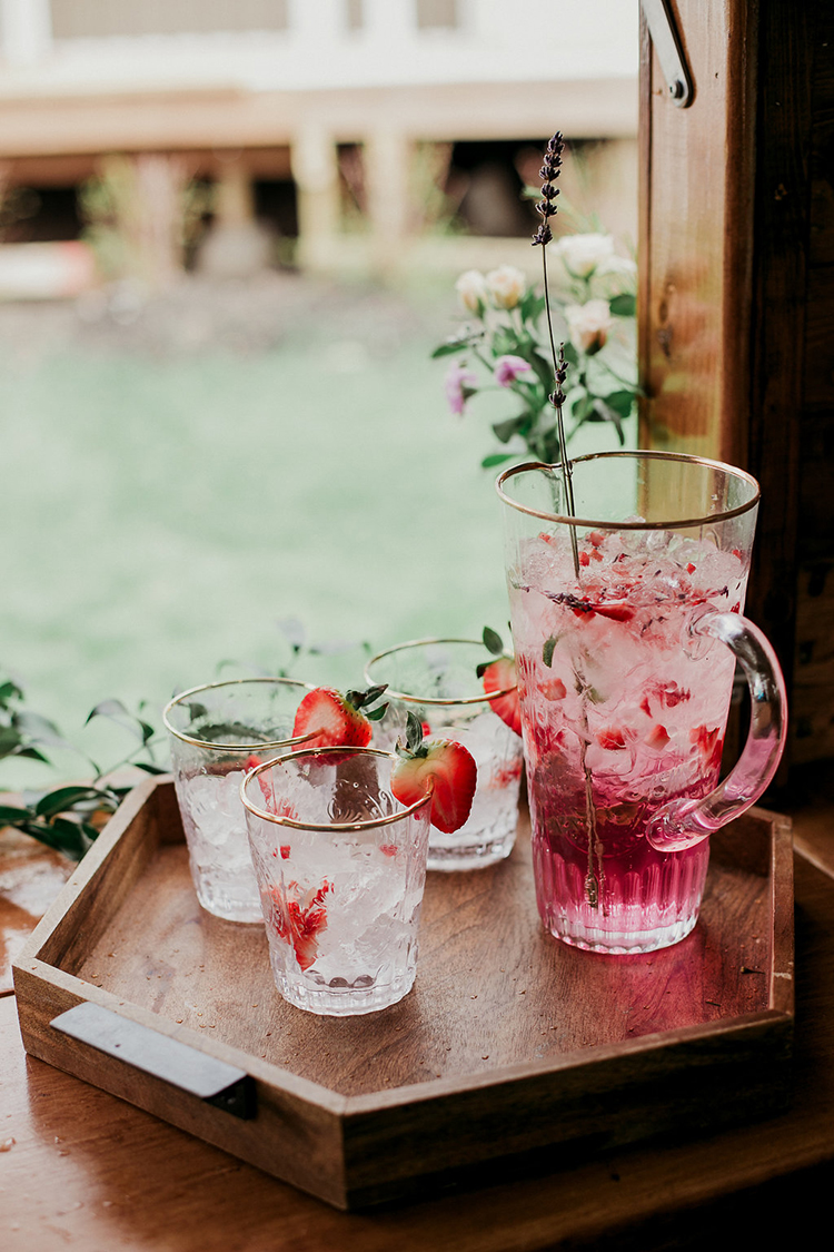flirty pink wedding drinks - photo by Sarah White Photography https://ruffledblog.com/boho-bridal-shower-inspiration-for-your-bride-tribe