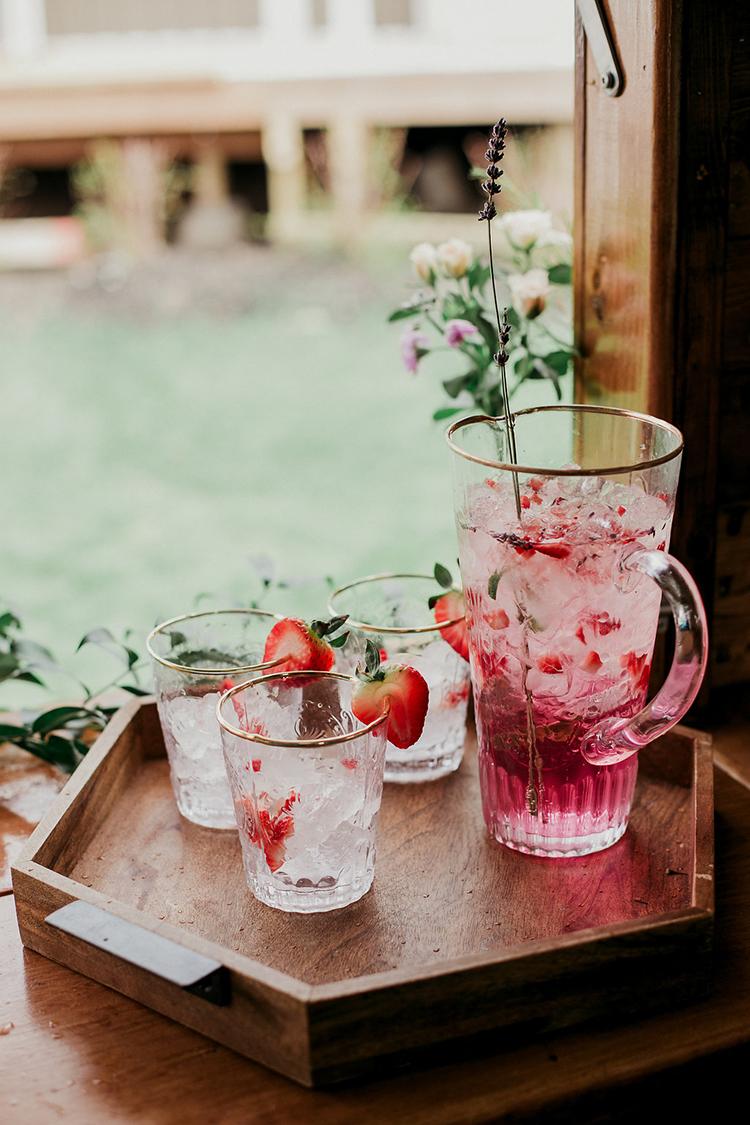 flirty pink wedding drinks - photo by Sarah White Photography http://ruffledblog.com/boho-bridal-shower-inspiration-for-your-bride-tribe
