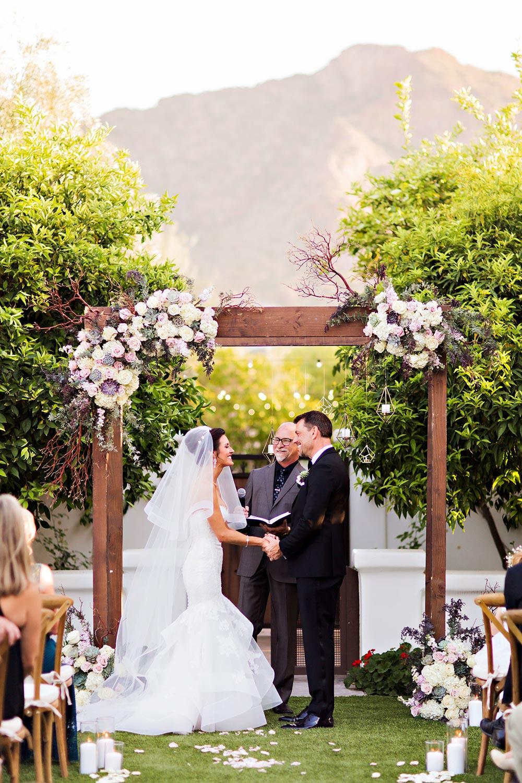 elegant outdoor wedding ceremony with floral arbor