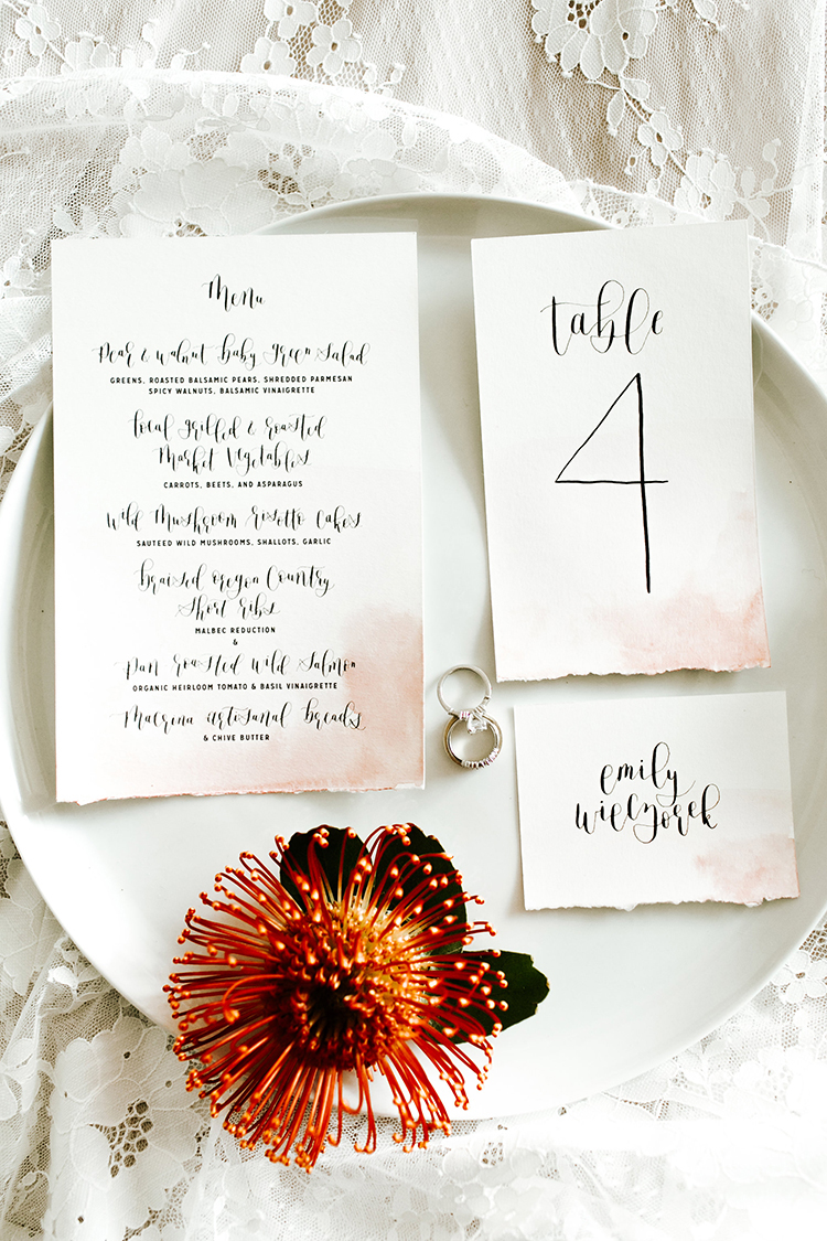 watercolor dipped wedding paper goods - photo by Jenna Bechtholt Photography https://ruffledblog.com/boho-pacific-northwest-forest-wedding-with-king-protea