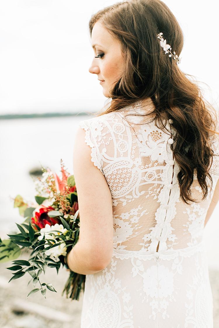 lace wedding dress details - photo by Jenna Bechtholt Photography https://ruffledblog.com/boho-pacific-northwest-forest-wedding-with-king-protea