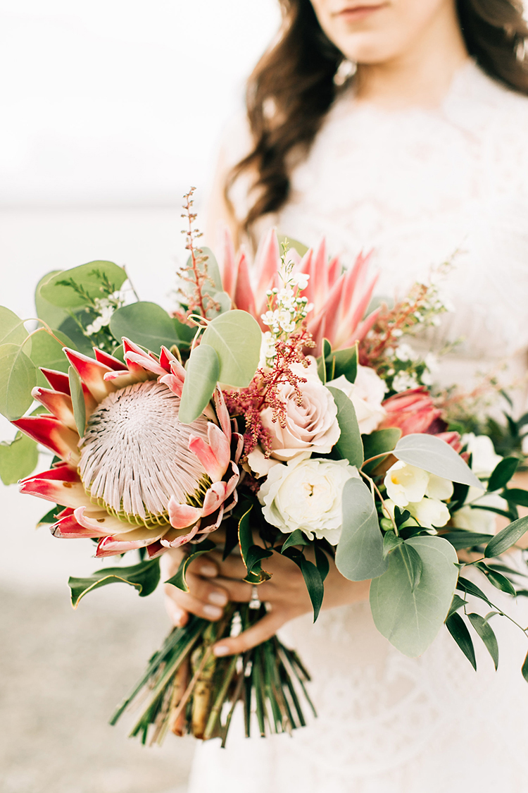king protea wedding bouquets - photo by Jenna Bechtholt Photography https://ruffledblog.com/boho-pacific-northwest-forest-wedding-with-king-protea
