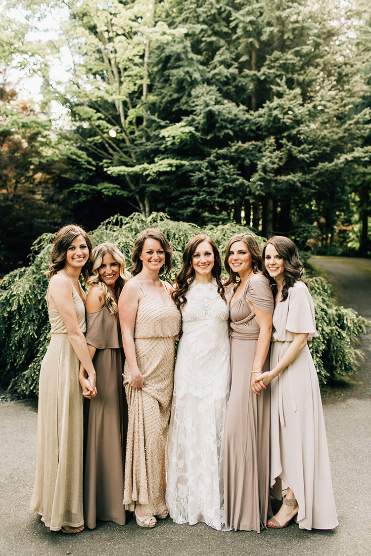 bridesmaids in neutral dresses - photo by Jenna Bechtholt Photography https://ruffledblog.com/boho-pacific-northwest-forest-wedding-with-king-protea