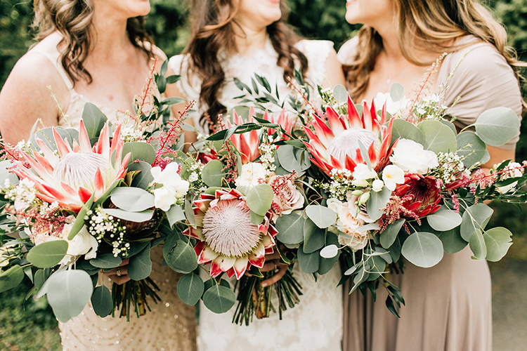 bouquets with king protea and eucalyptus - photo by Jenna Bechtholt Photography https://ruffledblog.com/boho-pacific-northwest-forest-wedding-with-king-protea