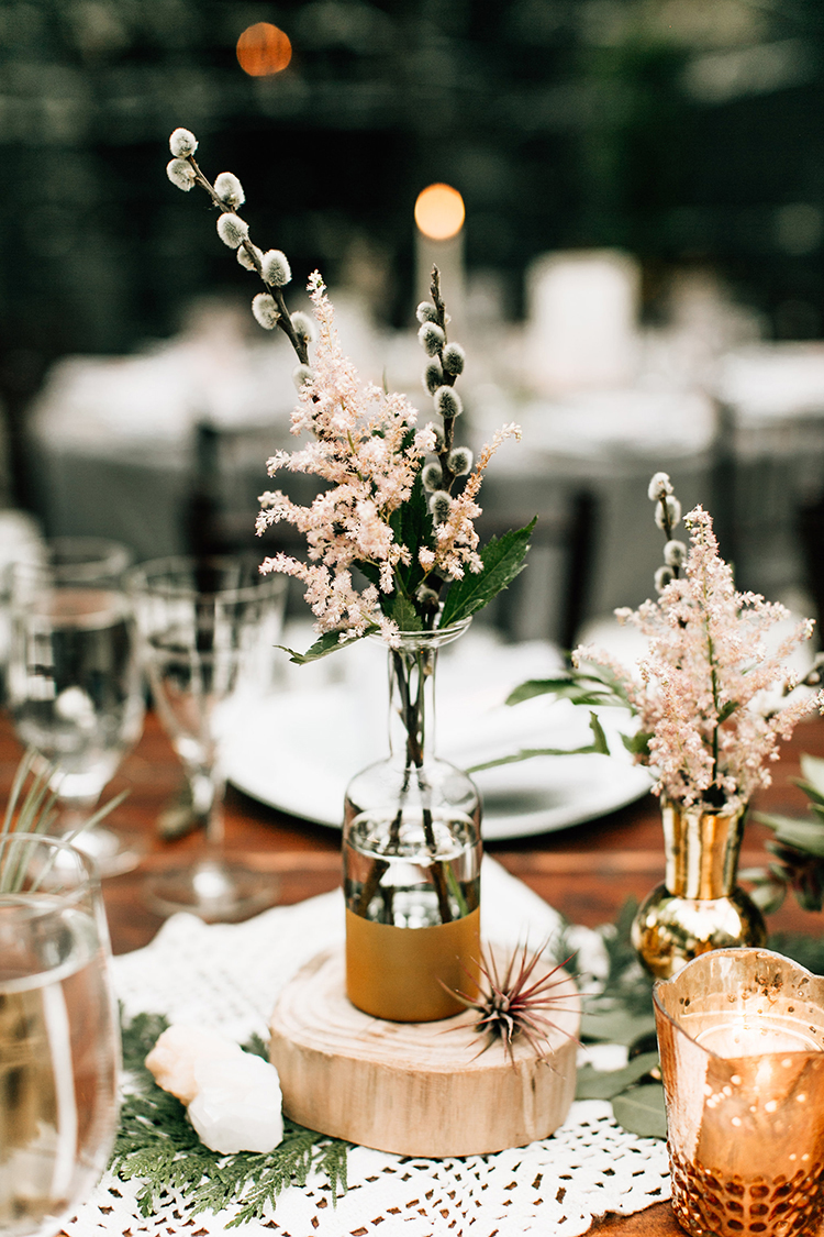 light pink centerpiece ideas - photo by Jenna Bechtholt Photography http://ruffledblog.com/boho-pacific-northwest-forest-wedding-with-king-protea