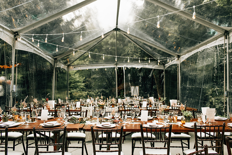 wedding receptions under clear tents - photo by Jenna Bechtholt Photography https://ruffledblog.com/boho-pacific-northwest-forest-wedding-with-king-protea