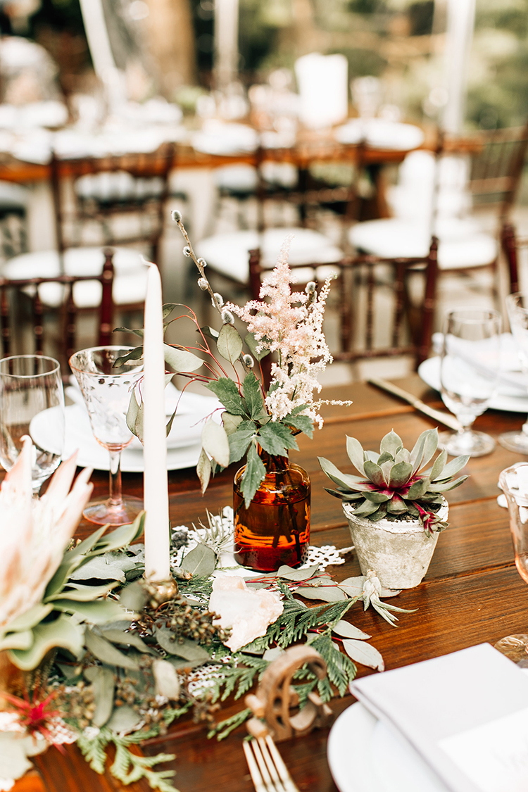romantic centerpiece ideas - photo by Jenna Bechtholt Photography http://ruffledblog.com/boho-pacific-northwest-forest-wedding-with-king-protea