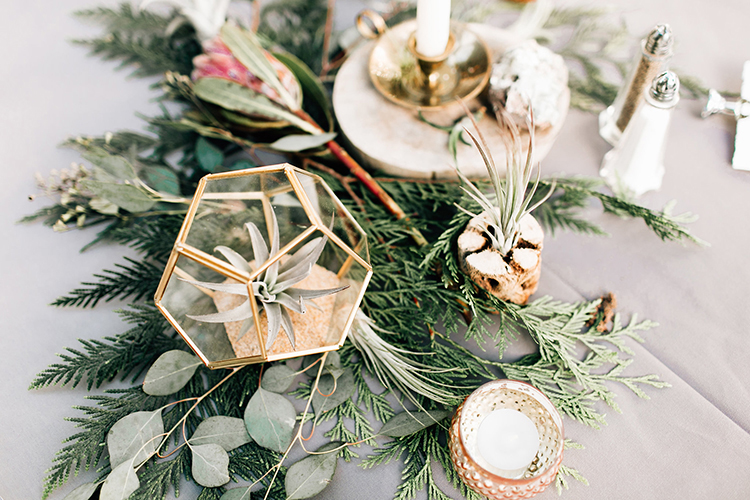 woodsy wedding centerpiece ideas - photo by Jenna Bechtholt Photography http://ruffledblog.com/boho-pacific-northwest-forest-wedding-with-king-protea