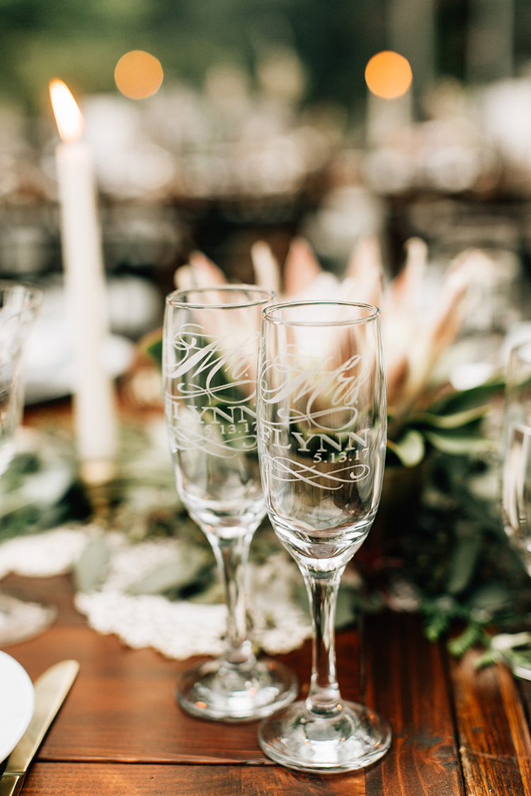 custom wedding champagne flutes - photo by Jenna Bechtholt Photography https://ruffledblog.com/boho-pacific-northwest-forest-wedding-with-king-protea