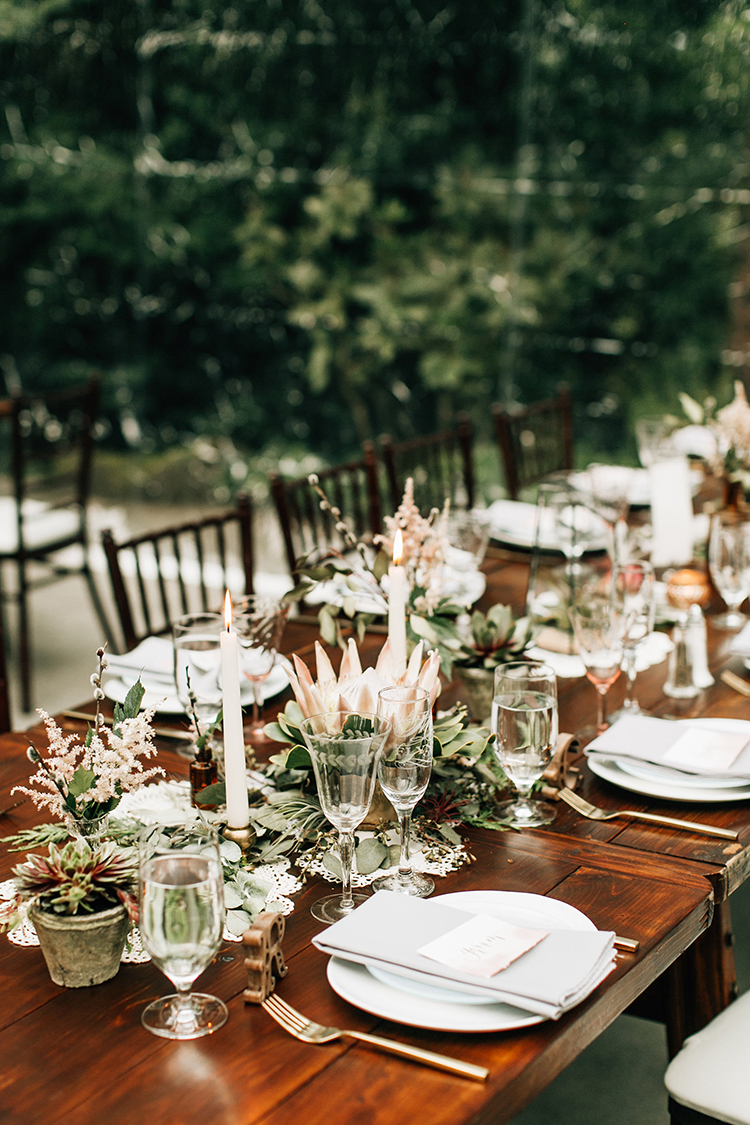wedding tablescapes - photo by Jenna Bechtholt Photography https://ruffledblog.com/boho-pacific-northwest-forest-wedding-with-king-protea