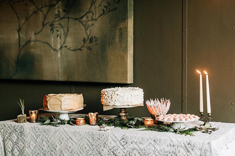 wedding cake tables - photo by Jenna Bechtholt Photography https://ruffledblog.com/boho-pacific-northwest-forest-wedding-with-king-protea