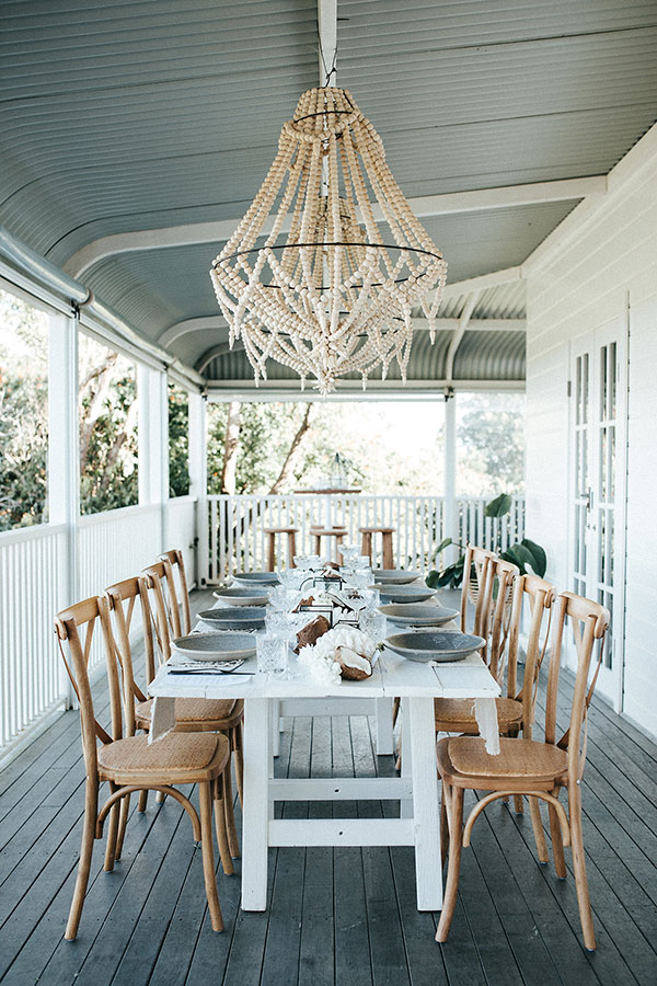Boho Porch Table with a Natural White Palette #entertaining #tablescape #weddingideas see more: https://ruffledblog.com/boho-porch-tablescape-ocean