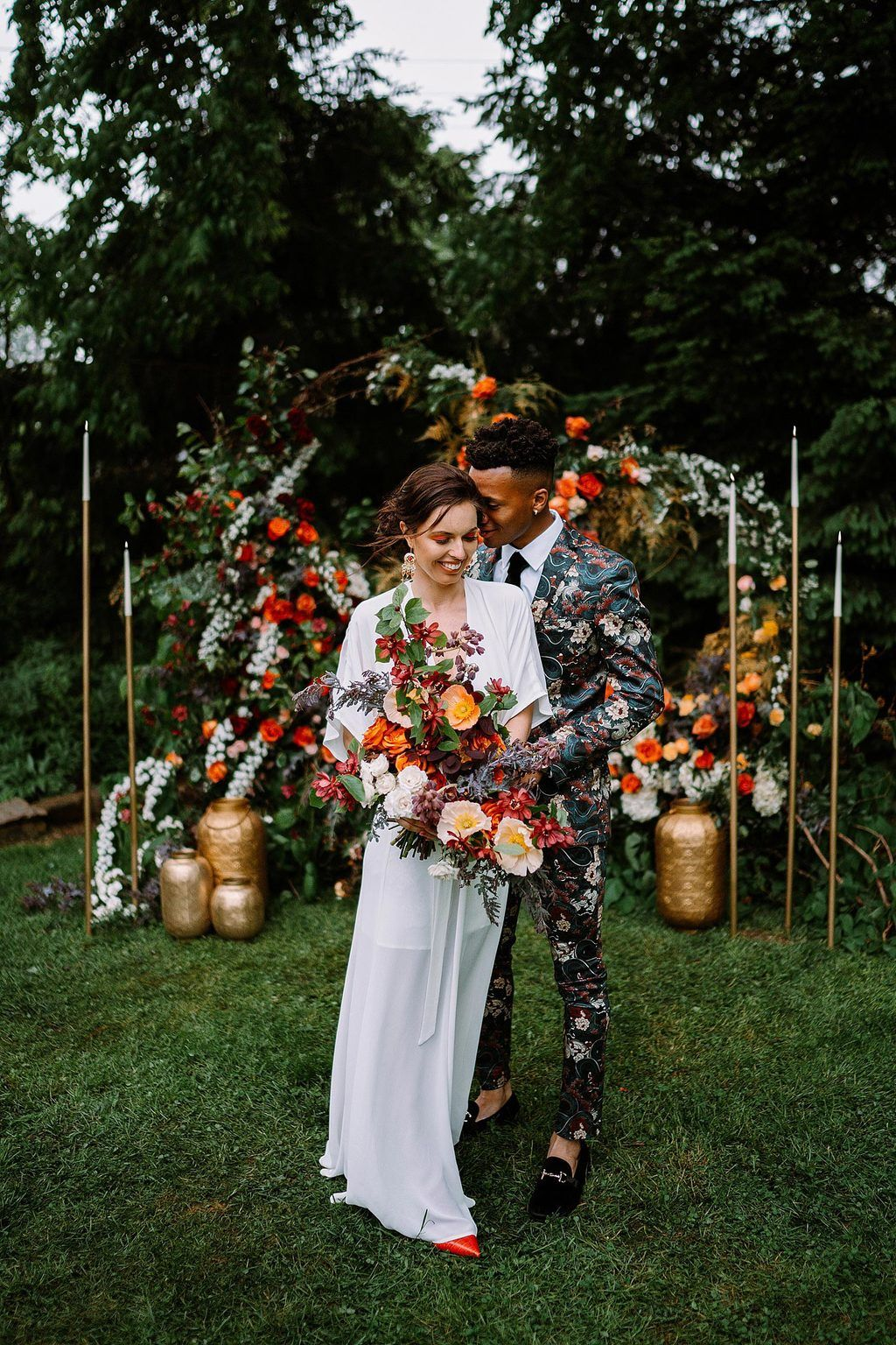 boho wedding inspiration with bride in flutter sleeve wedding dress and groom in floral print suit