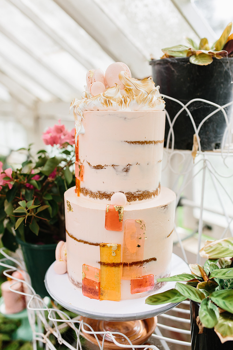 wedding cakes with geo accents - photo by Kas Richards https://ruffledblog.com/bold-bohemian-wedding-inspiration-with-a-balloon-display