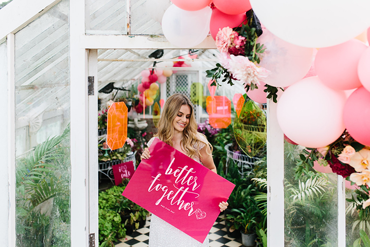 pink wedding signs - photo by Kas Richards https://ruffledblog.com/bold-bohemian-wedding-inspiration-with-a-balloon-display