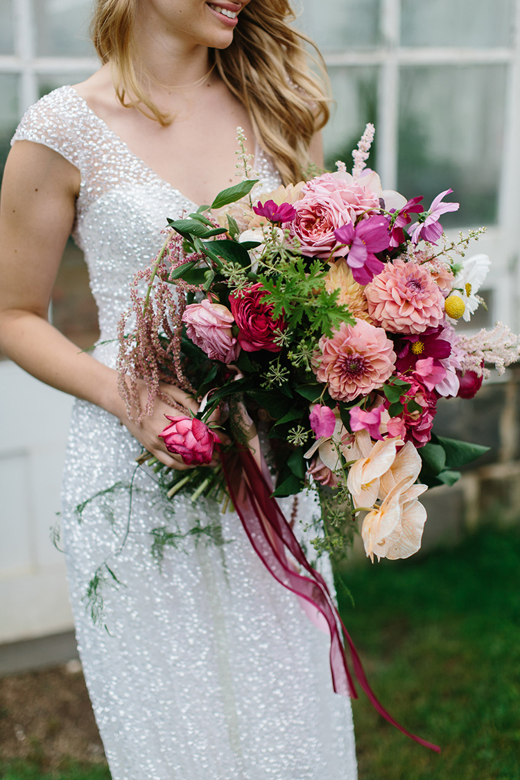 colorful bouquets with dahlias - photo by Kas Richards https://ruffledblog.com/bold-bohemian-wedding-inspiration-with-a-balloon-display