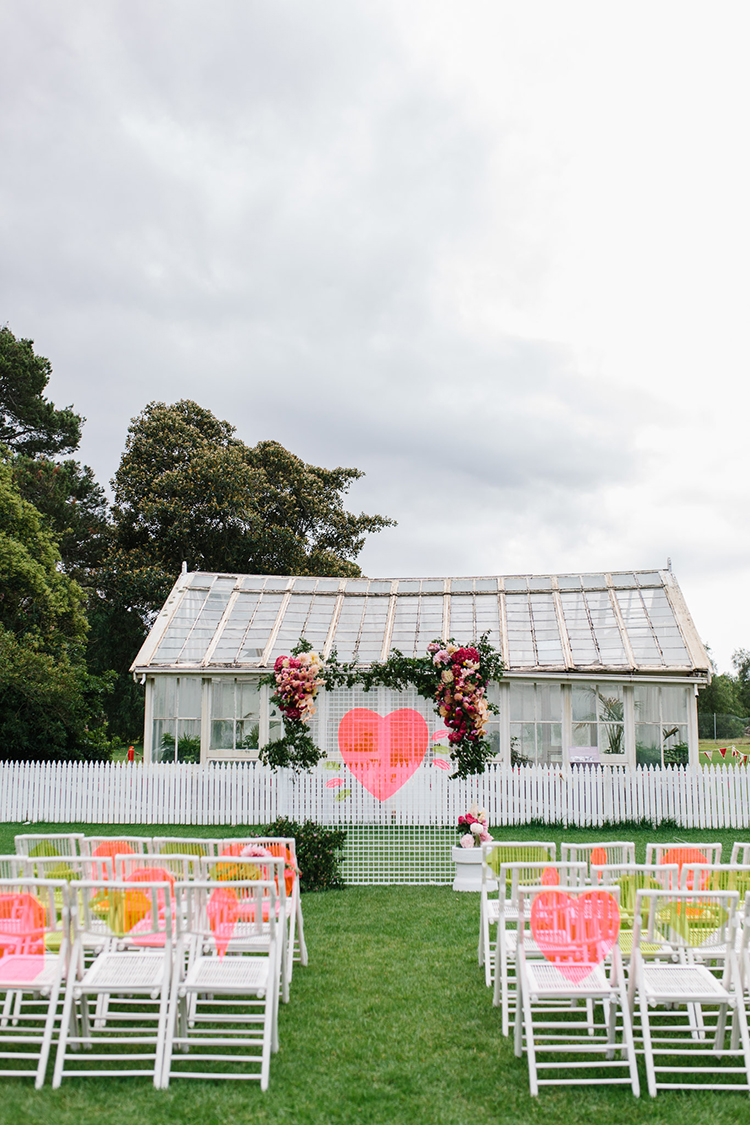 whimsical wedding ceremony ideas with hearts - photo by Kas Richards http://ruffledblog.com/bold-bohemian-wedding-inspiration-with-a-balloon-display