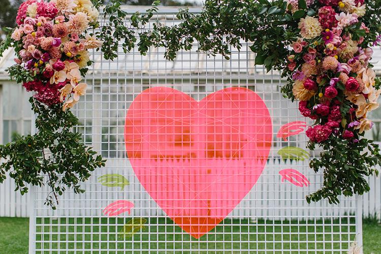 heart shaped ceremony backdrops - photo by Kas Richards http://ruffledblog.com/bold-bohemian-wedding-inspiration-with-a-balloon-display