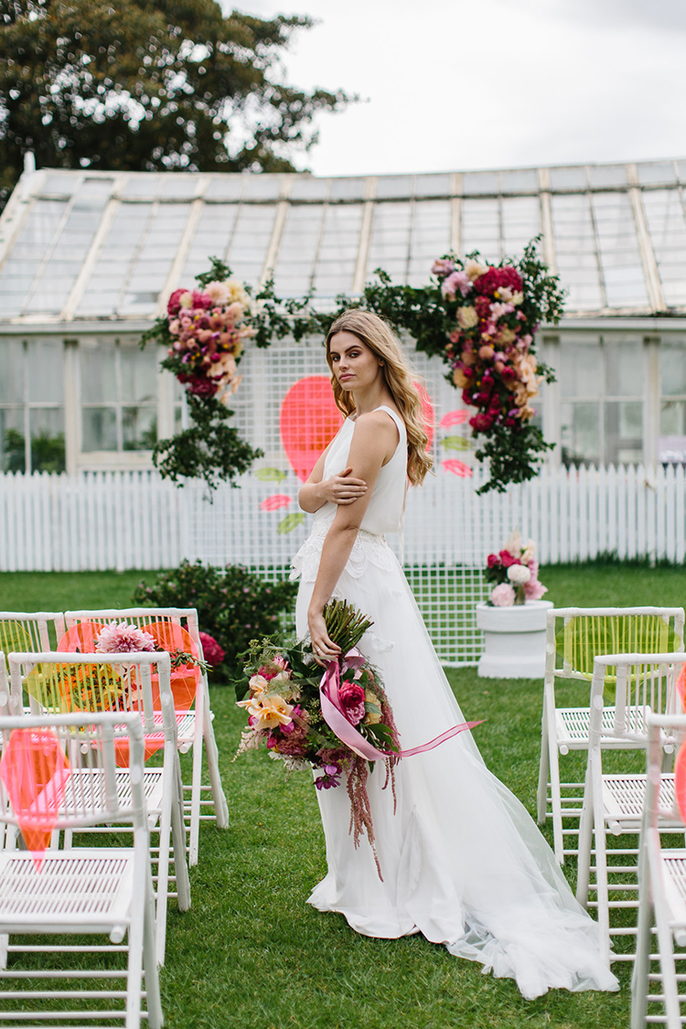 colorful boho wedding ideas - photo by Kas Richards https://ruffledblog.com/bold-bohemian-wedding-inspiration-with-a-balloon-display