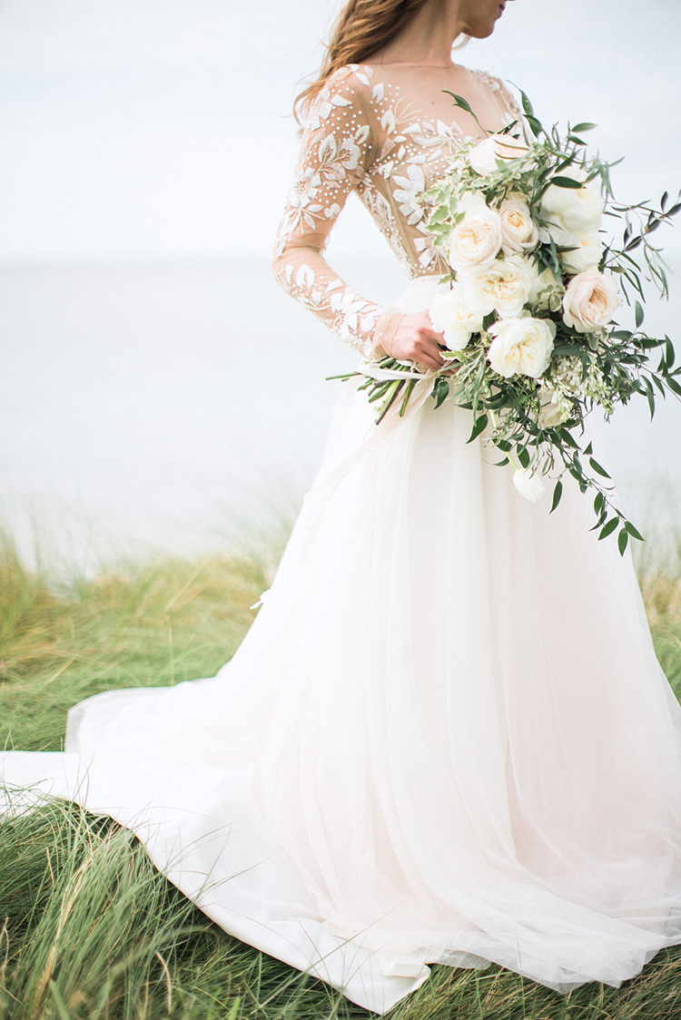 Breezy Seaside Wedding with Cascading Greenery - photo by Hunter Ryan Photo http://ruffledblog.com/breezy-seaside-wedding-with-cascading-greenery