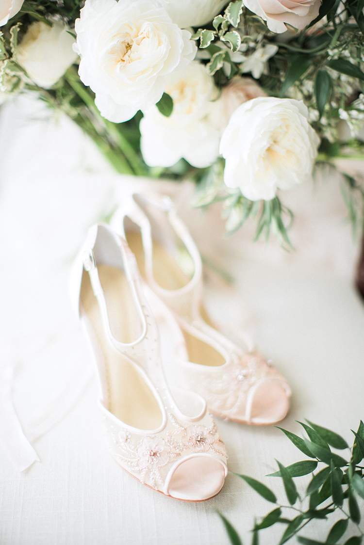 champagne wedding shoes - photo by Hunter Ryan Photo https://ruffledblog.com/breezy-seaside-wedding-with-cascading-greenery