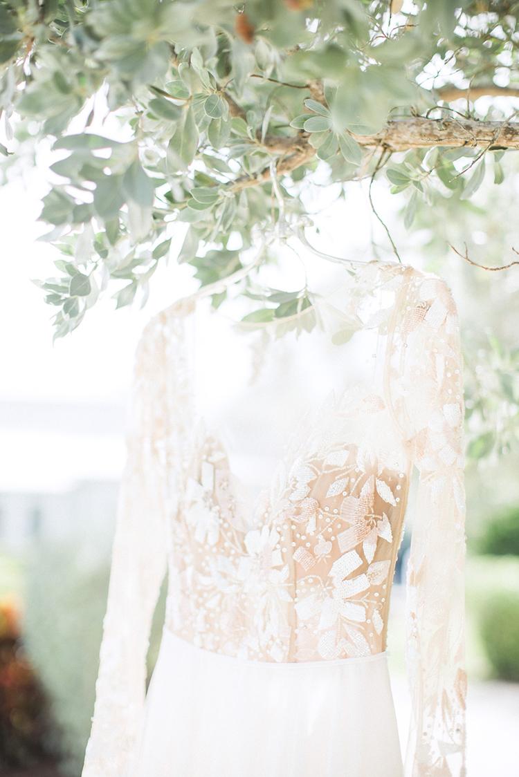 lace wedding dresses - photo by Hunter Ryan Photo http://ruffledblog.com/breezy-seaside-wedding-with-cascading-greenery