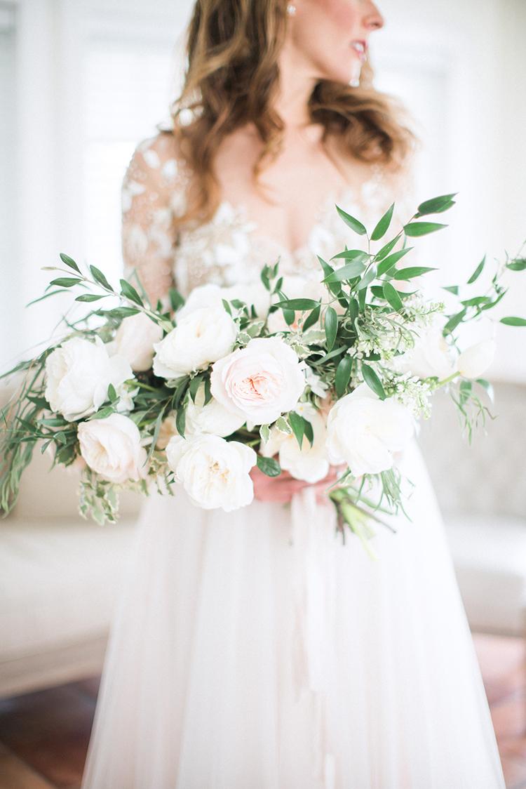 leafy bridal bouquets - photo by Hunter Ryan Photo http://ruffledblog.com/breezy-seaside-wedding-with-cascading-greenery