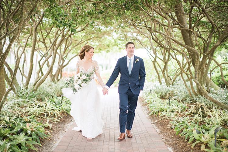 wedding portraits - photo by Hunter Ryan Photo https://ruffledblog.com/breezy-seaside-wedding-with-cascading-greenery