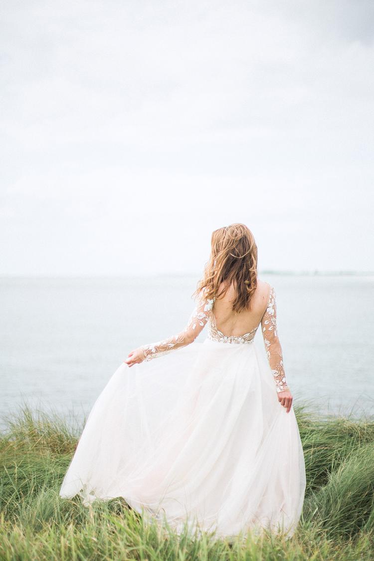 Hayley Paige wedding gowns - photo by Hunter Ryan Photo http://ruffledblog.com/breezy-seaside-wedding-with-cascading-greenery