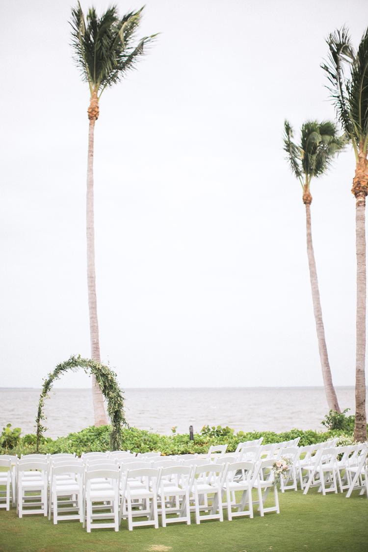 beachside wedding ceremonies - photo by Hunter Ryan Photo http://ruffledblog.com/breezy-seaside-wedding-with-cascading-greenery