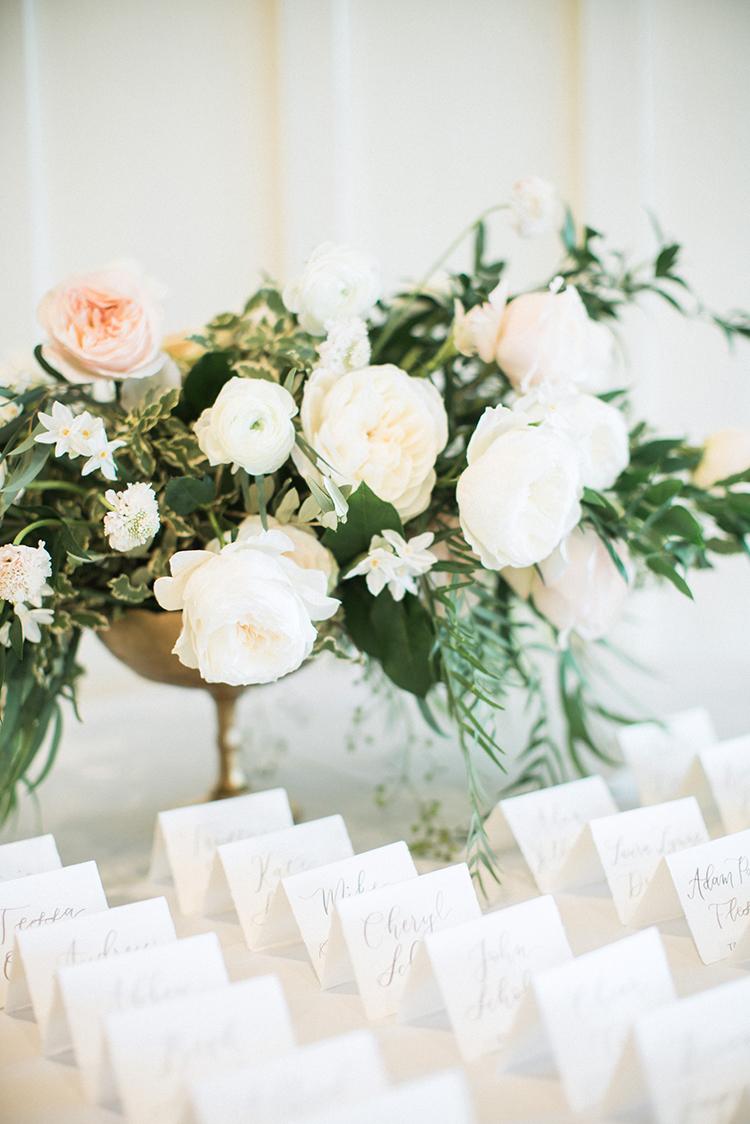 ivory wedding flowers - photo by Hunter Ryan Photo http://ruffledblog.com/breezy-seaside-wedding-with-cascading-greenery