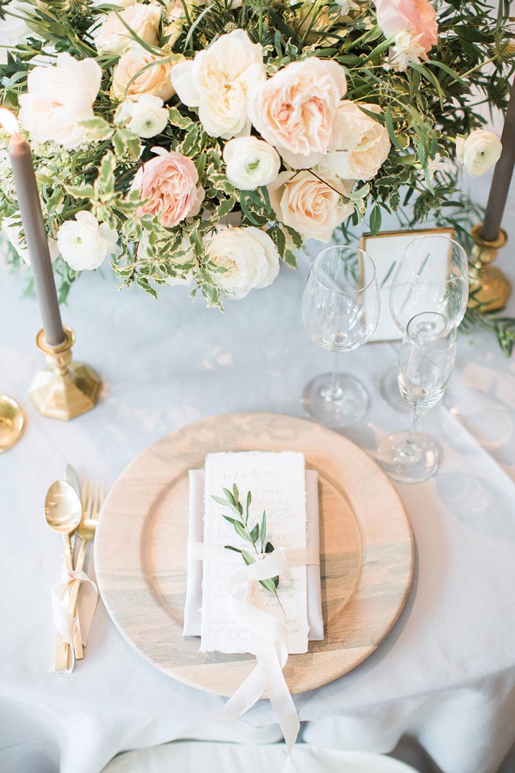 soft and romantic table settings - photo by Hunter Ryan Photo http://ruffledblog.com/breezy-seaside-wedding-with-cascading-greenery