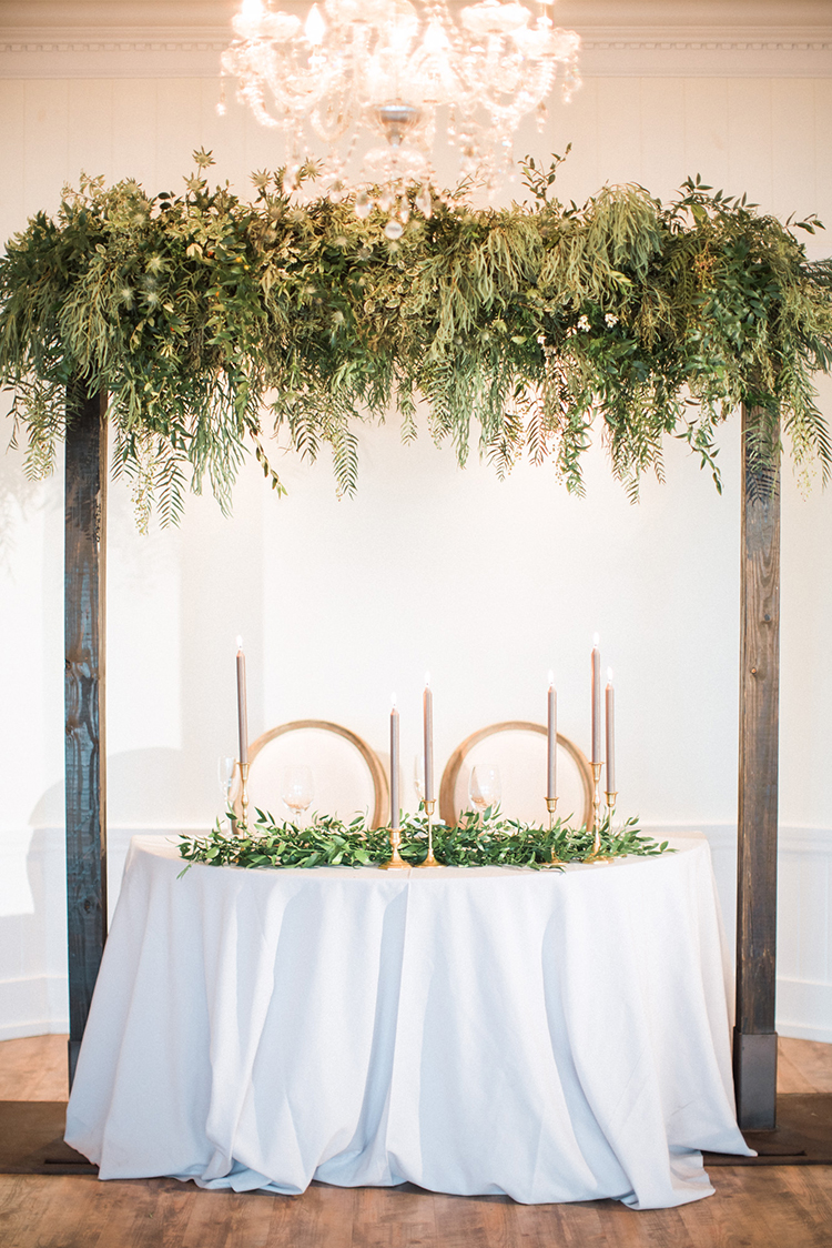 sweetheart tables with greenery - photo by Hunter Ryan Photo https://ruffledblog.com/breezy-seaside-wedding-with-cascading-greenery