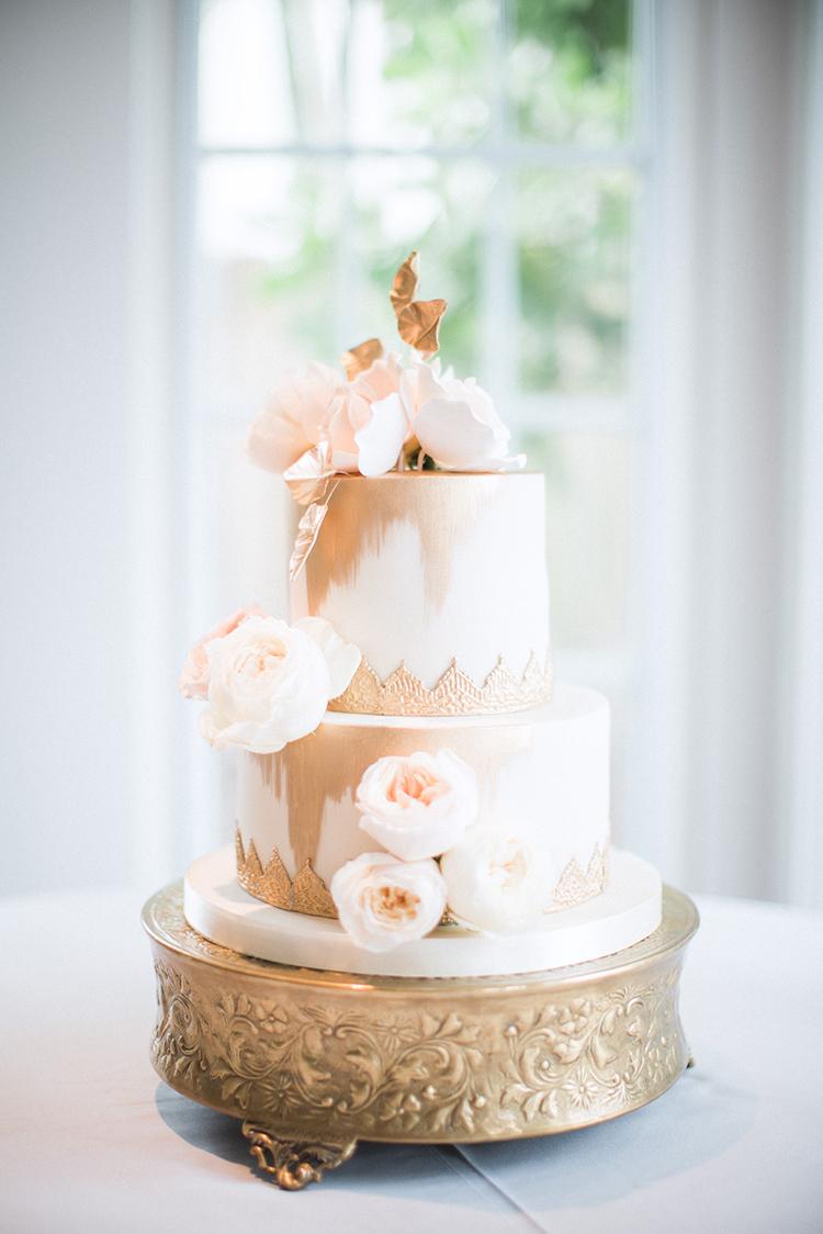 gold ikat wedding cakes - photo by Hunter Ryan Photo http://ruffledblog.com/breezy-seaside-wedding-with-cascading-greenery