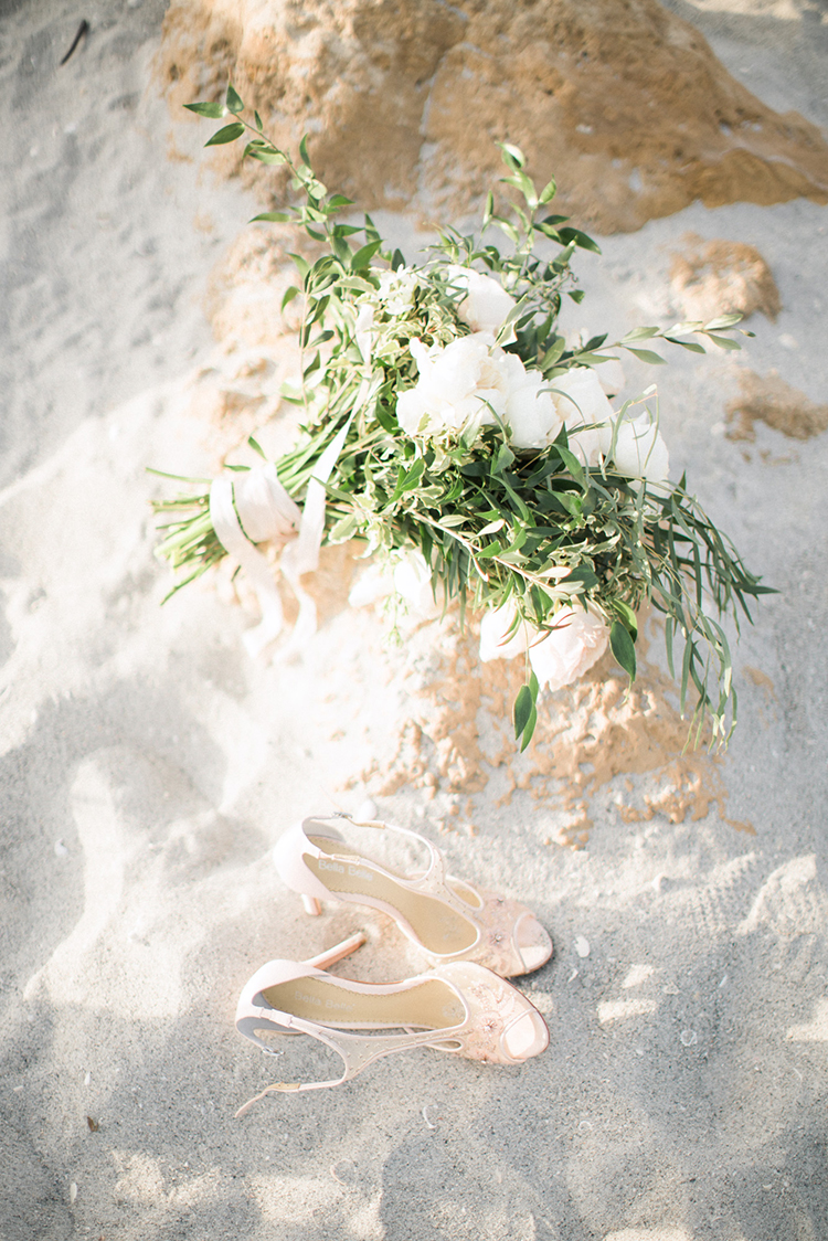 beach weddings - photo by Hunter Ryan Photo http://ruffledblog.com/breezy-seaside-wedding-with-cascading-greenery