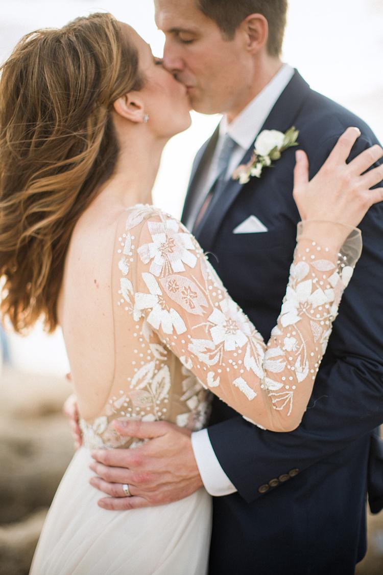 romantic wdeding dress sleeves - photo by Hunter Ryan Photo http://ruffledblog.com/breezy-seaside-wedding-with-cascading-greenery