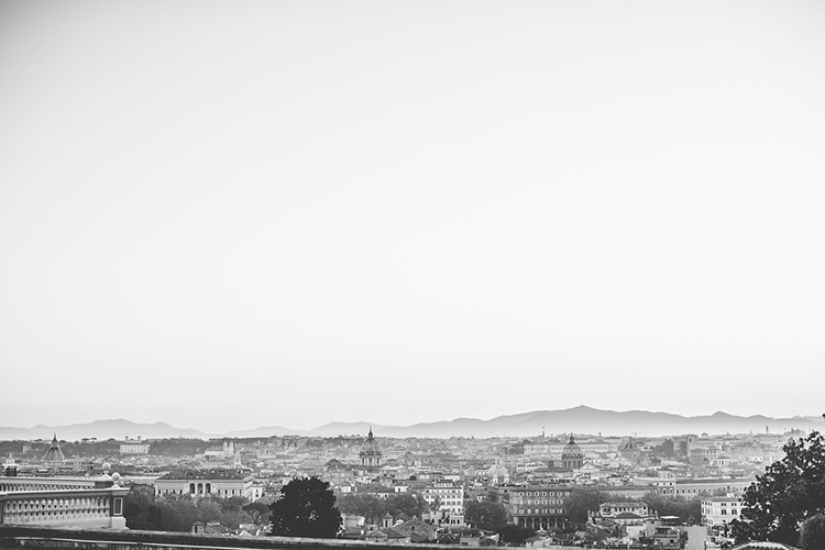 cityscapes of Rome - photo by Lilly Red Creative https://ruffledblog.com/bridal-portraits-during-a-roman-sunrise