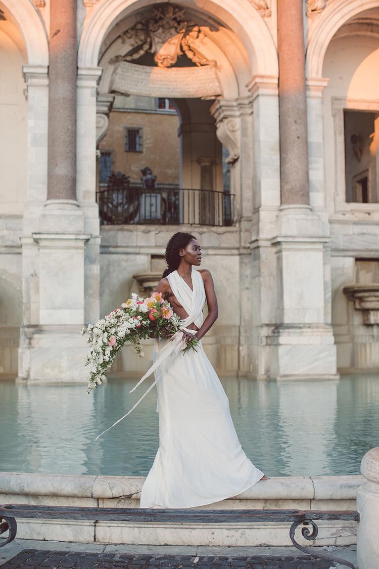 elegant bridal looks - photo by Lilly Red Creative https://ruffledblog.com/bridal-portraits-during-a-roman-sunrise
