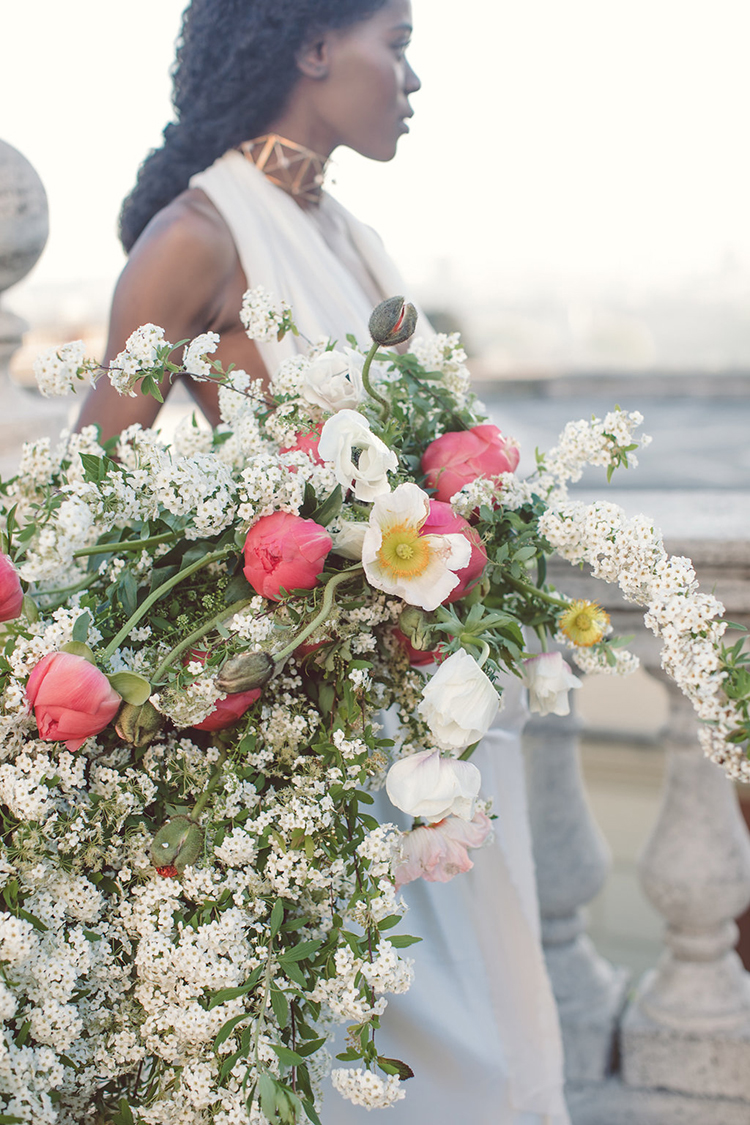 lush wedding bouquets with tulips - photo by Lilly Red Creative https://ruffledblog.com/bridal-portraits-during-a-roman-sunrise