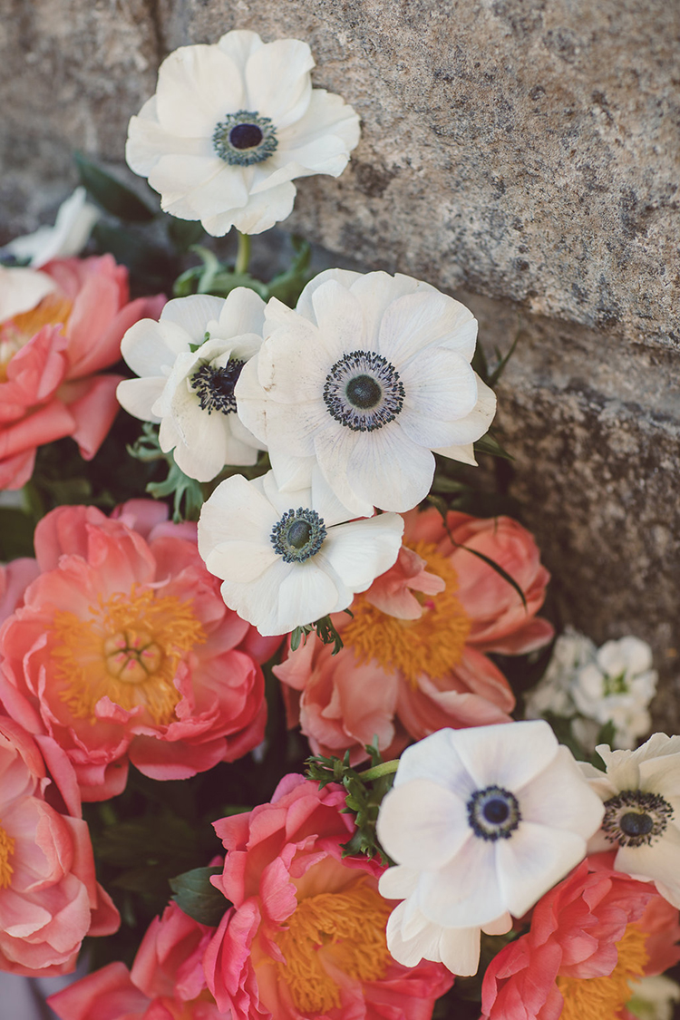 floral arrangements with anemones - photo by Lilly Red Creative https://ruffledblog.com/bridal-portraits-during-a-roman-sunrise