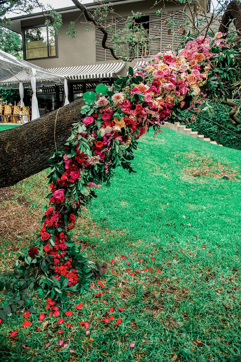 floral arch ceremony - https://ruffledblog.com/bright-and-bold-austin-wedding photo Jennifer Lindberg