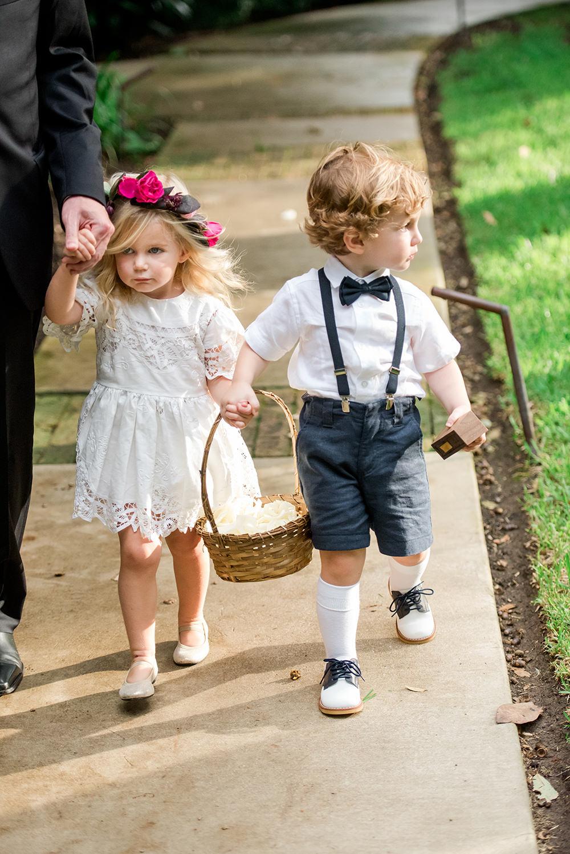adorable flower girl and ring bearer outfits  - http://ruffledblog.com/bright-and-bold-austin-wedding photo Jennifer Lindberg