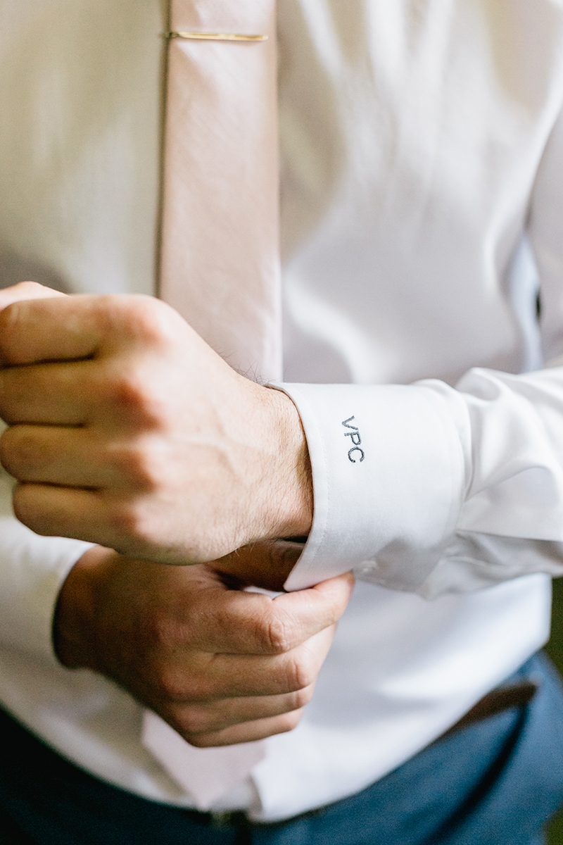 groom getting ready - photo by Emily Wren Photography https://ruffledblog.com/bright-beautiful-summer-wedding-with-geometric-accents