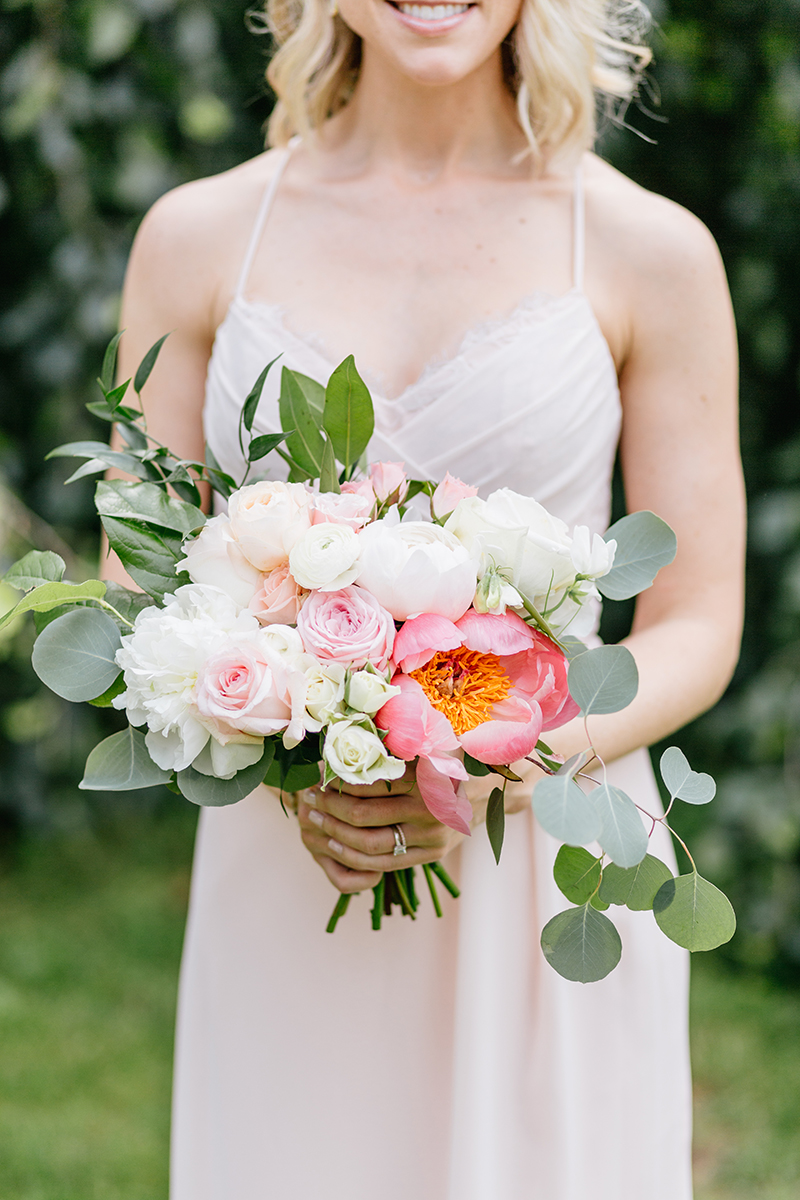 coral charm peony bridesmaid bouquets - photo by Emily Wren Photography https://ruffledblog.com/bright-beautiful-summer-wedding-with-geometric-accents
