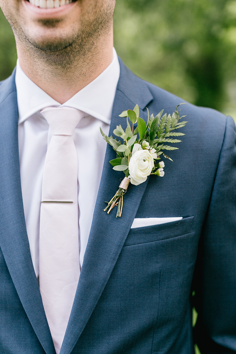 simple summer boutonnieres - photo by Emily Wren Photography https://ruffledblog.com/bright-beautiful-summer-wedding-with-geometric-accents