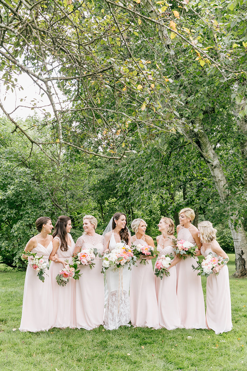 blush pink bridesmaid dresses - photo by Emily Wren Photography http://ruffledblog.com/bright-beautiful-summer-wedding-with-geometric-accents