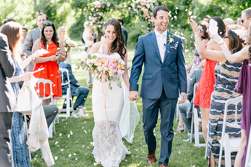 ceremony recessionals - photo by Emily Wren Photography https://ruffledblog.com/bright-beautiful-summer-wedding-with-geometric-accents